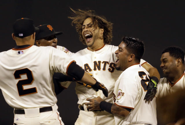 San Francisco Giants' Michael Morse, center, celebrates after making the game winning single in the ninth inning of a baseball game against the New York Mets Saturday, June 7, 2014, in San Francisco. (AP Photo/Ben Margot)