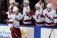 Carolina Hurricanes left wing Jordan Martinook (48) is congratulated by teammates after scoring a goal during the second period of an NHL hockey game against the Florida Panthers, Thursday, April 22, 2021, in Sunrise, Fla. (AP Photo/Marta Lavandier)