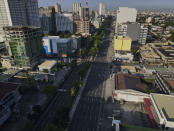 An almost empty Quezon Boulevard is seen as the government implements a strict lockdown to prevent the spread of the coronavirus on Good Friday, April 2, 2021 in Quezon city, Philippines. Filipinos marked Jesus Christ's crucifixion Friday in one of the most solemn holidays in Asia's largest Catholic nation which combined with a weeklong coronavirus lockdown to empty Manila's streets of crowds and heavy traffic jams. Major highways and roads were eerily quiet on Good Friday and churches were deserted too after religious gatherings were prohibited in metropolitan Manila and four outlying provinces. (AP Photo/Aaron Favila)