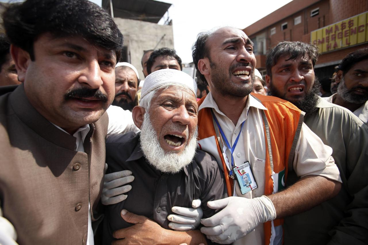 A man cries over the death of his son, who was killed in a bomb blast, at a hospital in Peshawar September 29, 2013. Twin blasts in the northwestern Pakistan city of Peshawar killed 33 people and wounded 70 on Sunday, a week after two bombings at a church in the frontier city killed scores, police and hospital authorities said.REUTERS/ Fayaz Aziz (PAKISTAN - Tags: CIVIL UNREST POLITICS CRIME LAW)