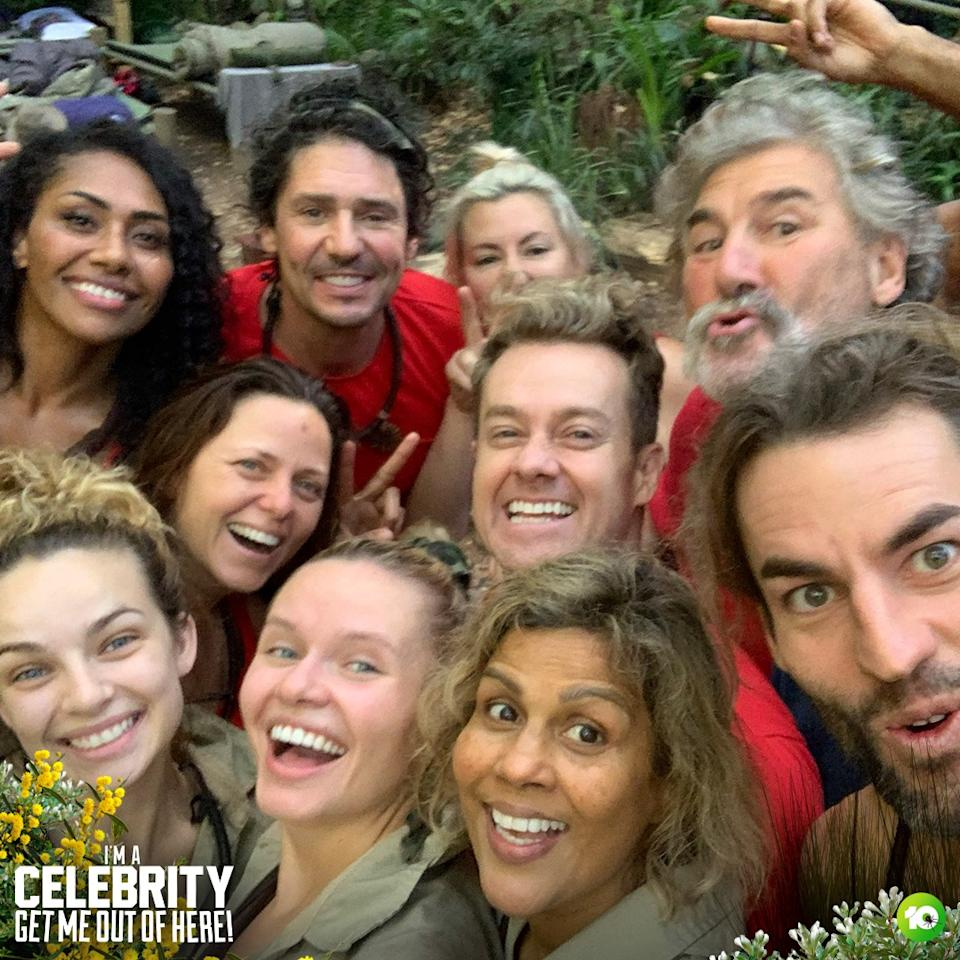 stars of I'm A Celebrity get me out of here australia 2021 pose for a selfie in camp