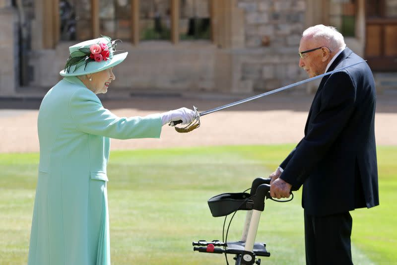 Arise Sir Tom: Queen Elizabeth knights 100-year-old fundraising captain