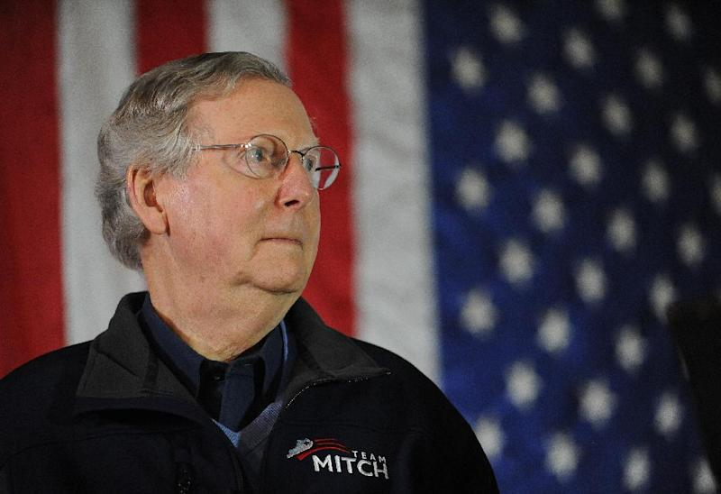 FILE - In this Feb. 8, 2014 file photo, Sen. Mitch McConnell, R-Ky., waits to speak during a campaign stop at Badgett Supply in Madisonville, Ky. Republican senators are attacking GOP challengers earlier and more aggressively than in past elections, including using opposition research to try to knock out upstart rivals before they become serious threats. Matt Bevin is the tea party-backed challenger to McConnell. (AP Photo/Stephen Lance Dennee, File)