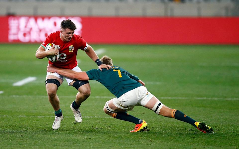 Pieter-Steph du Toit of South Africa tackling Tom Curry - PA