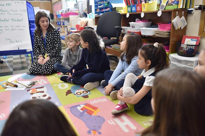 Julianne Belsito, a kindergarten teacher, leads her class in a morning meeting at Helen I. Smith Elementary School, which uses mindfulness programs in their curriculum in Saddle Brook, N.J.