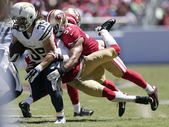 San Diego Chargers running back Danny Woodhead (39) runs against San Francisco 49ers defensive back Chris Culliver, center, and linebacker Michael Wilhoite (57) during the first quarter of an NFL preseason football game in Santa Clara, Calif., Sunday, Aug. 24, 2014. (AP Photo/Marcio Jose Sanchez)