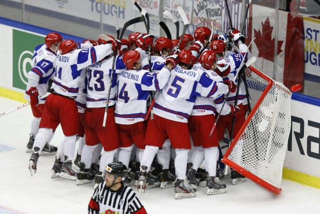 Russia's players celebrate after defeating the U.S. team in their IIHF Ice Hockey World Championship quarter-final match in Malmo