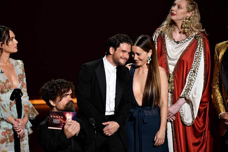 Kit Harington and Emilia Clarke, center right, join their 'Game of Thrones' castmates for an awards presentation at the Emmys. Their show later won best drama.