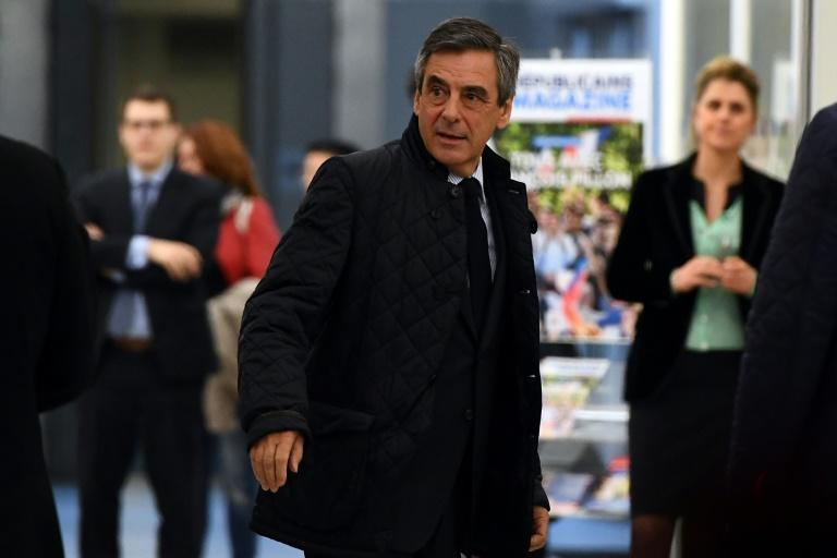 French presidential candidate for the right-wing Les Republicains (LR) party Francois Fillon arrives at headquarters for talks with party leaders