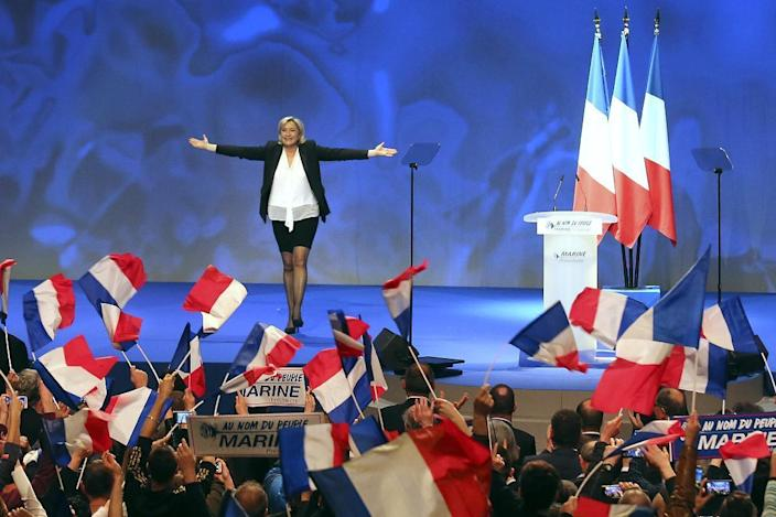 FILE - In this Sunday, Feb. 26, 2017 file photo, French Far-right leader presidential candidate Marine Le Pen gestures at the start of a conference in Nantes, western France. The European Parliament voted Thursday, March 2 to lift French far-right leader Marine Le Pen's immunity from prosecution for tweeting gruesome images of violence, a crime carrying a maximum sentence of three years in prison. (AP Photo/David Vincent, file)