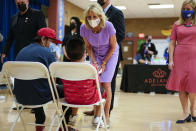 First lady Jill Biden speaks with people during a tour of a COVID-19 vaccination site at Isaac Middle School in Phoenix, Wednesday, June 30, 2021. Phoenix Mayor Kate Gallego is at right. (AP Photo/Carolyn Kaster, Pool)