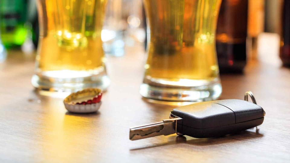 Car key with alcohol drinks on a table in a pub