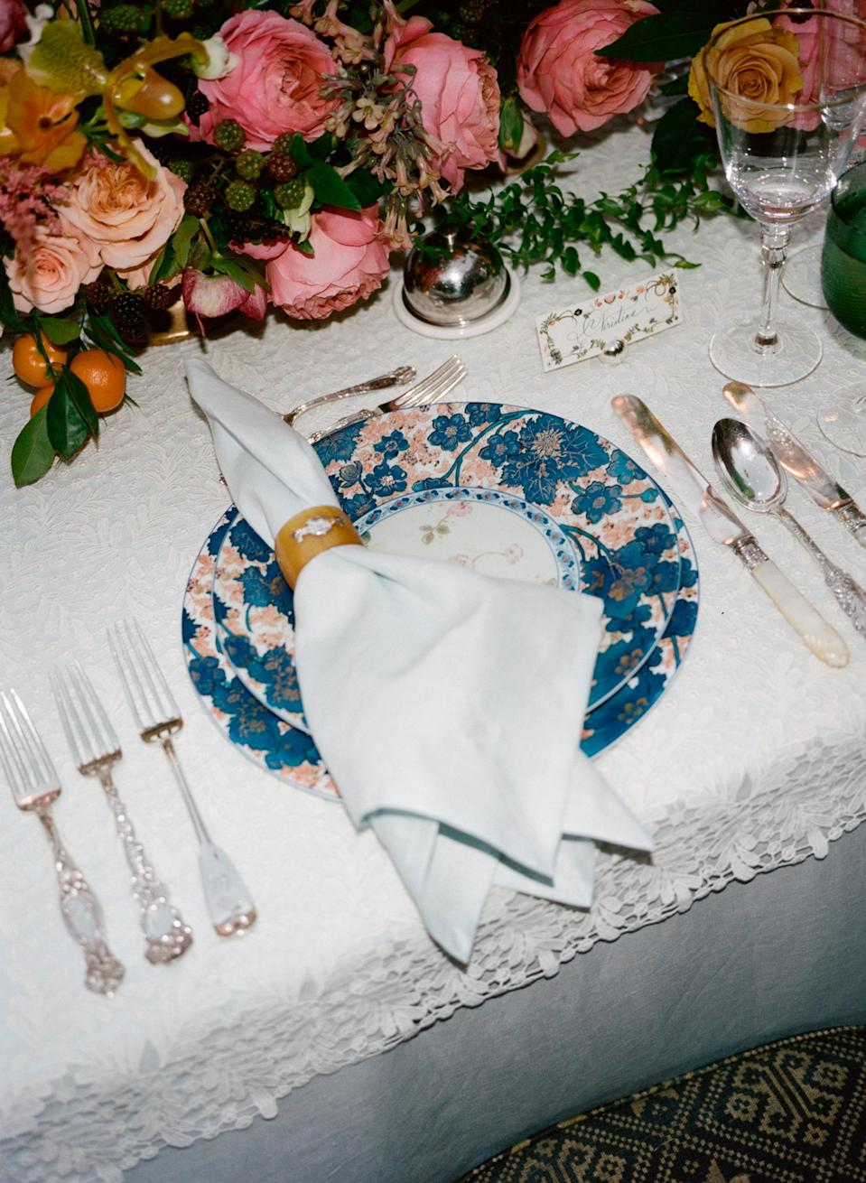 """One more view of the pieces at play on our table. Here you can better see our china, silver, and linens with the antique horn and sliver napkin rings. The napkins were embroidered with a subtle tonal """"H"""" for our last name, Herbert."""