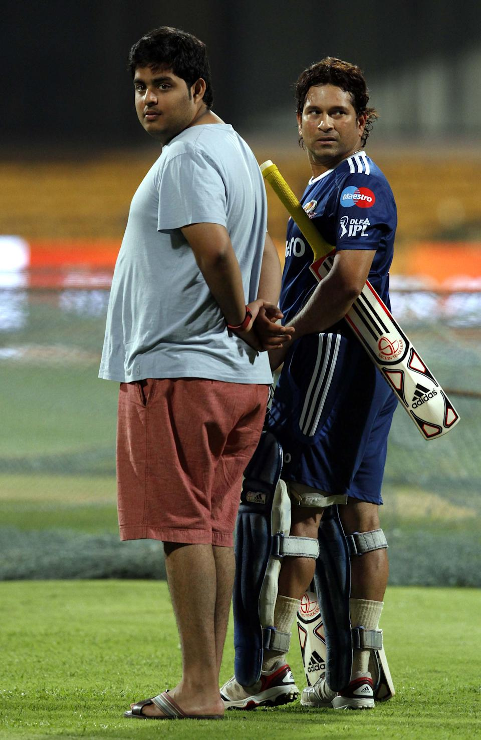 BANGALORE, INDIA - MAY 22: Mumbai Indians Batsman Sachin Tendulkar with Anant Ambani, son of Mukesh Ambani and owner of Mumbai Indians during the team practice session at M Chinnaswamy stadium on May 22, 2012 in Bangalore, India. Chennai Super Kings will play Mumbai Indians in eliminator 1 on May 23, 2012. The winner of this tie will then play Delhi Daredevils to decide the finalist. Kolkata Knight Riders have already qualified for final. (Photo by Virendra Singh Gosain / Hindustan Times via Getty Images)