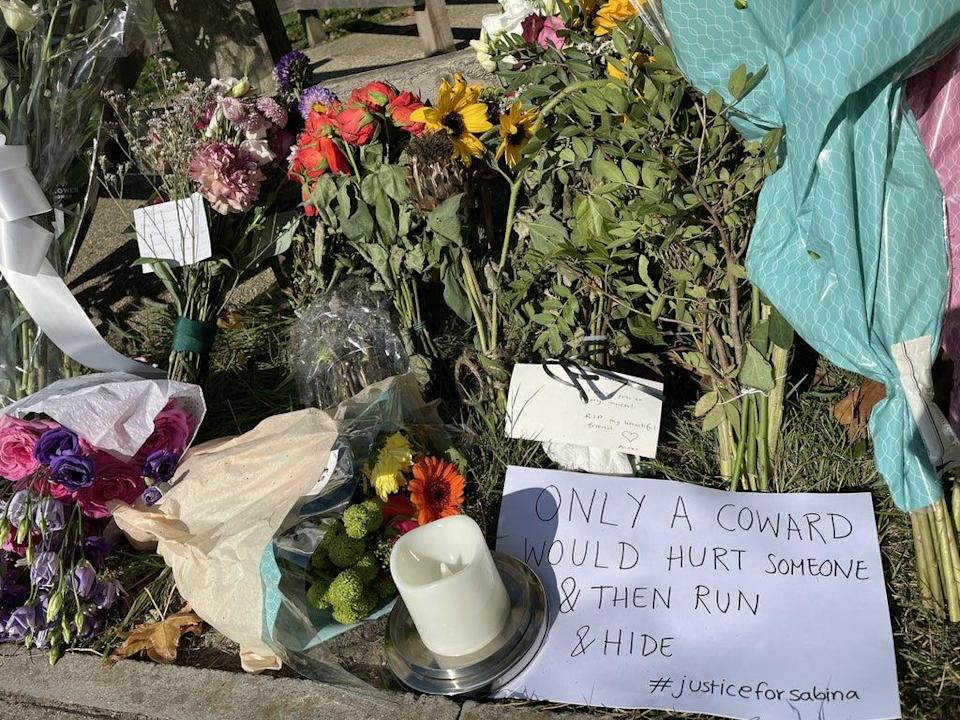 Floral tributes at Cator Park in Kidbrooke, south-east London, near to the scene where the body of Sabina Nessa was found (Laura Parnaby/PA) (PA Wire)