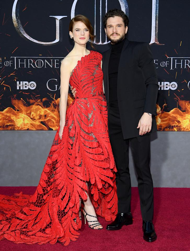 <p>Rose Leslie chose a red one-shoulder Oscar de la Renta gown while husband Kit Harington wore a slick black suit. <em>[Photo: Getty]</em> </p>