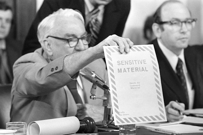 """<p>Chairman Sam Ervin, D-N.C., holds up """"sensitive material"""" envelope on June 5, 1973, in the Senate Caucus Room during the testimony of Sally J. Harmony before the Senate Watergate Committee. Ervin asked Harmony whether she could identify the envelope, she said she could not. (Photo: AP) </p>"""