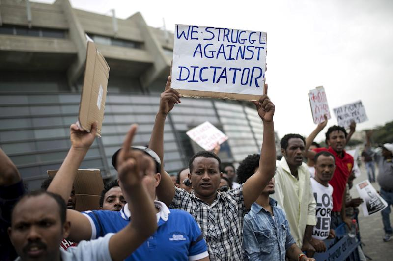 Eritrean refugees protest against the Eritrean government outside the nation's embassy in Tel Aviv, Israel, in 2015. (Baz Ratner / Reuters)