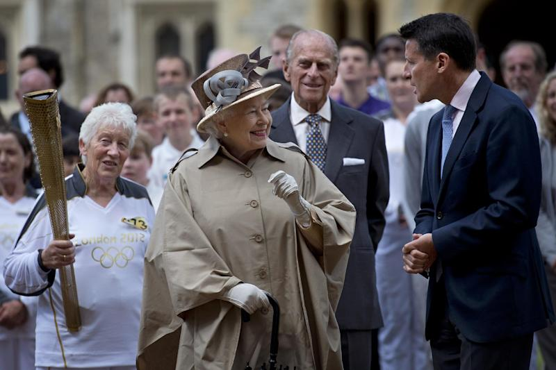 Britain's Queen Elizabeth II, second left, her husband Prince Philip, second right, London 2012 Chairman Sebastian Coe, right, and seventy four year-old Olympic torch bearer Gina Macgregor,  left, at Windsor Castle, Windsor, England Tuesday July 10, 2012. The London 2012 Olympic Games will start on July 27, 2012.   (AP Photo/Ben Stansall, Pool)