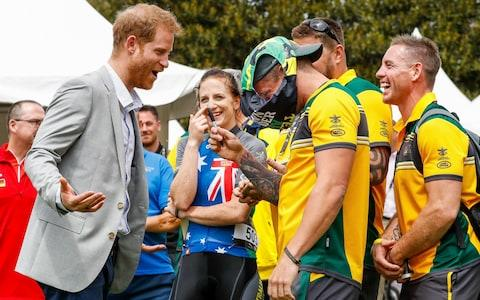 Prince Harry, Duke of Sussex joking around signing budgie smugglers on day two of the Invictus Games - Credit: Chris Jackson/Getty Images