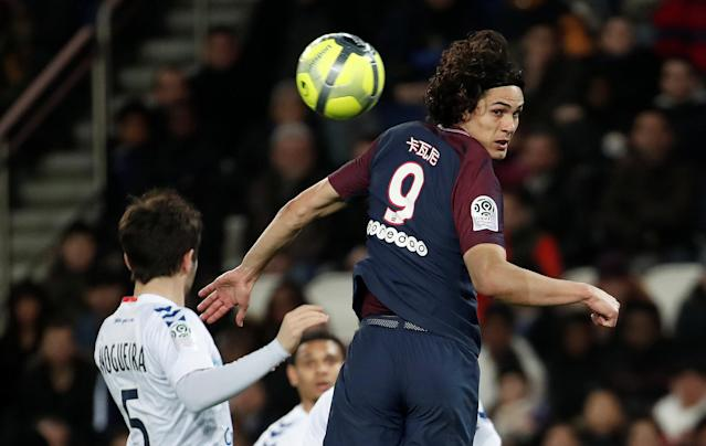 Soccer Football - Ligue 1 - Paris St Germain vs RC Strasbourg - Parc des Princes, Paris, France - February 17, 2018 Paris Saint-Germain's Edinson Cavani in action with Strasbourg's Vincent Nogueira REUTERS/Benoit Tessier