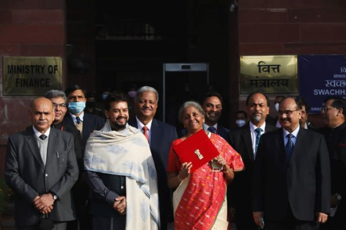 India's Finance Minister Nirmala Sitharaman holds up a folder with the Government of India logo, as she leaves her office to present the federal budget in the parliament in New Delhi