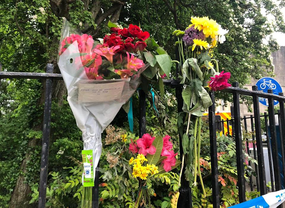 Floral tributes in West Princes Street in the Woodlands area of Glasgow following the death of pensioner Esther Brown whose body was found in her flat in suspicious circumstances. Picture date: Thursday June 3, 2021.