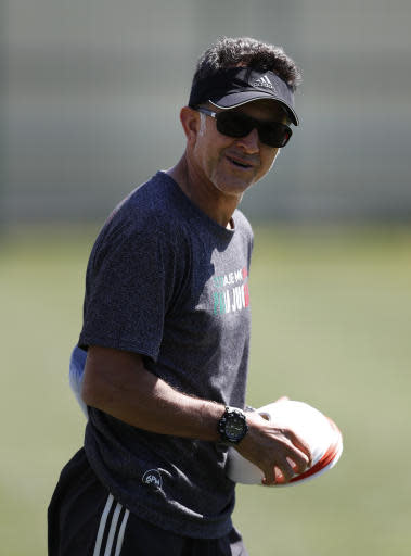 Mexico head coach Juan Carlos Osorio walks in the field during a training session of Mexico at the 2018 soccer World Cup in Moscow, Russia, Wednesday, June 20, 2018. (AP Photo/Eduardo Verdugo)