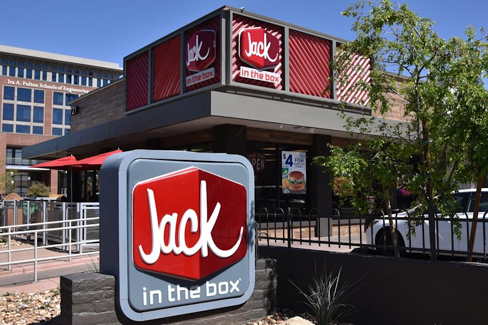 A sign for and exterior of Jack in the Box restaurant in Temple, Arizona