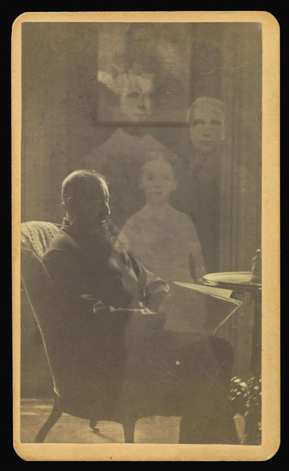 """<p>A bearded Massachusetts man naps in an armchair as the """"spirits"""" of his children watch over him. </p>"""
