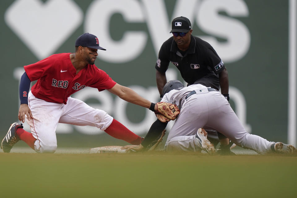 New York Yankees' Gleyber Torres, front right, steals second base as Boston Red Sox's Xander Bogaerts, left, tries to tag him in the eighth inning of a baseball game, Sunday, July 25, 2021, in Boston. (AP Photo/Steven Senne)