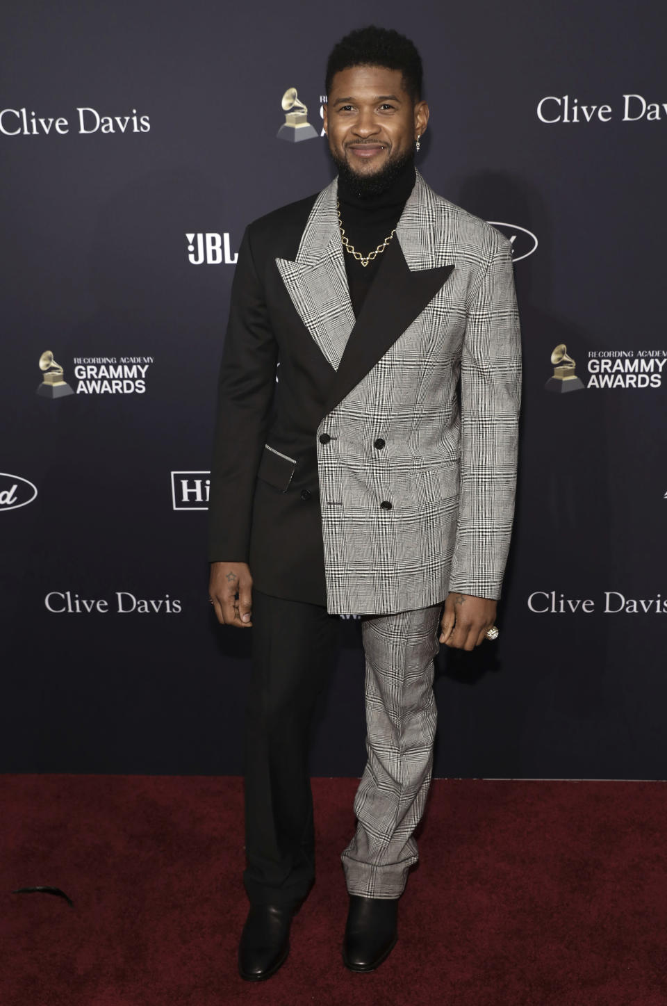 Usher arrives at the Pre-Grammy Gala And Salute To Industry Icons at the Beverly Hilton Hotel on Saturday, Jan. 25, 2020, in Beverly Hills, Calif. (Photo by Mark Von Holden/Invision/AP)