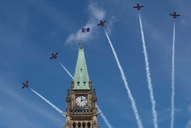 Royal Canadian Air Force Snowbirds and a CF-18 perform a flypast during the Canada Day noon show on Parliament Hill in 2019. (Justin Tang/Canadian Press - image credit)