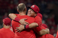 St. Louis Cardinals' Lars Nootbaar, right, hugs teammate Paul Goldschmidt as they celebrate after defeating the Milwaukee Brewers in a baseball game to clinch a playoff spot Tuesday, Sept. 28, 2021, in St. Louis. (AP Photo/Jeff Roberson)