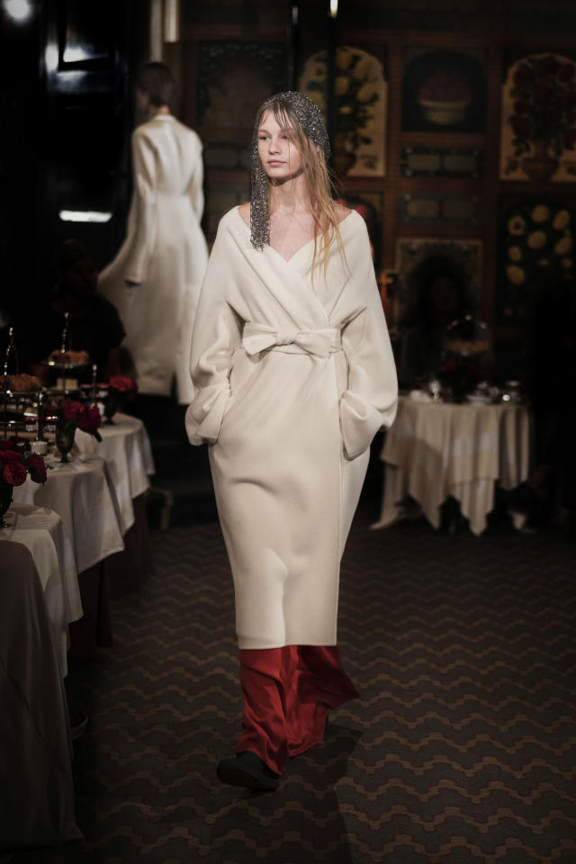 <p><i>Model wears a cream-color wrap dress from the SS18 The Row collection. (Photo: ImaxTree) </i></p>
