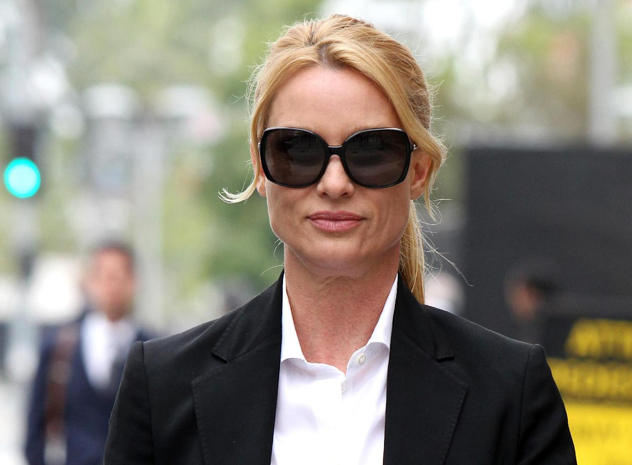 """FILE - In this March 13, 2012 file photo, """"Desperate Housewives"""" star, Nicollette Sheridan arrives at court in Los Angeles. A Los Angeles judge on Friday Oct. 18, 2013, dismissed Sheridan's long-running lawsuit against ABC over her release from """"Desperate Housewives."""" Sheridan contended she was fired because she complained the show's creator hit her on set, but ABC denied any wrongdoing. (AP Photo/Nick Ut, file)"""
