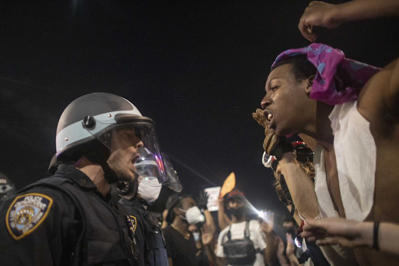 Protesters clash with police officers during a protest on May 30, 2020.