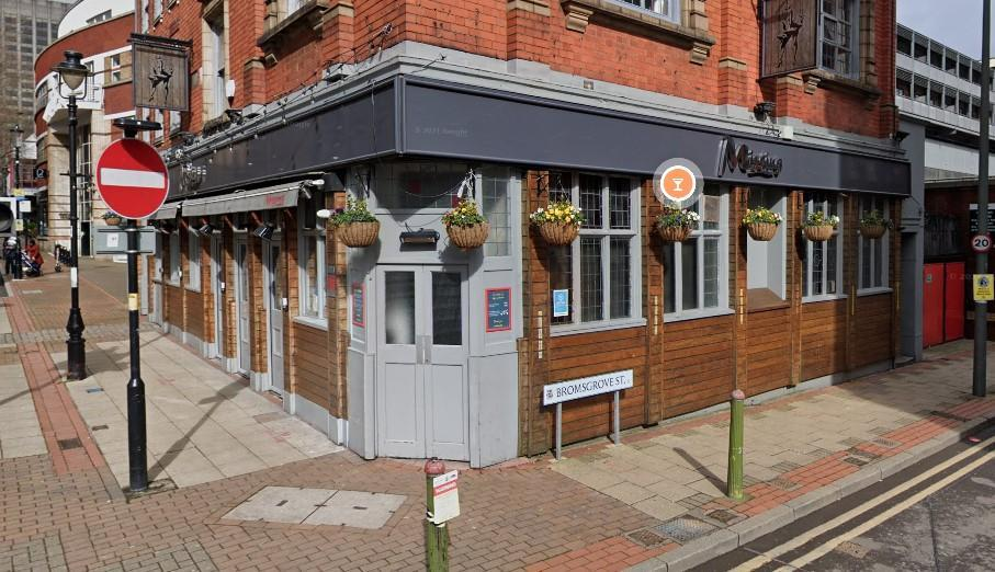 Homophobic abuse was shouted at the gay couple as they stood outside the Missing Bar