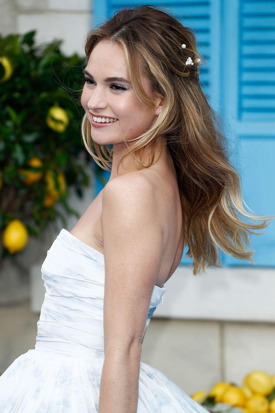 "<p>For an ethereal ""I-just-frolicked-through-a-flower-field-in-Provence"" look, add small floral details like Lily James. </p>"