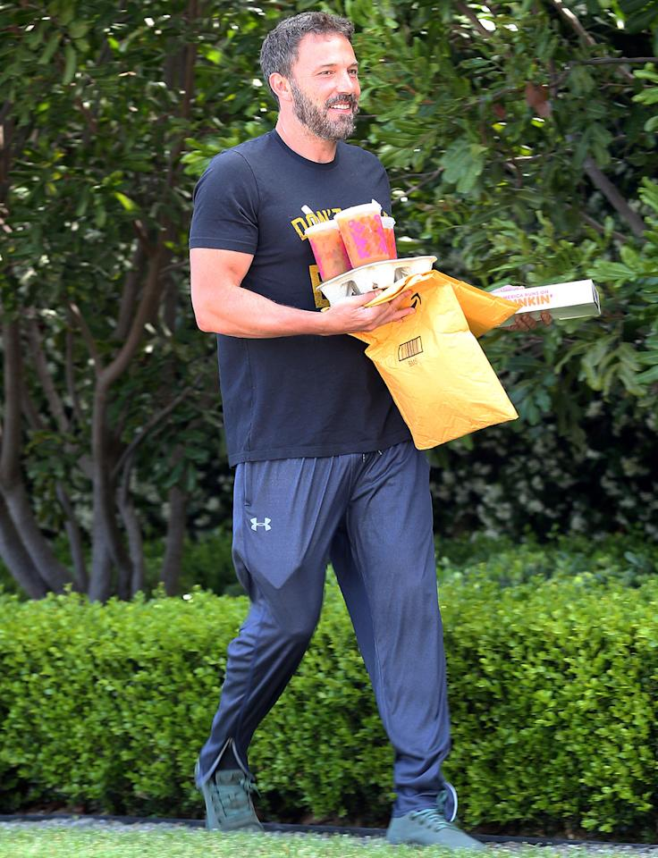 <p>A smiling Ben Affleck grabs his Dunkin and the mail on Saturday morning in Los Angeles. </p>