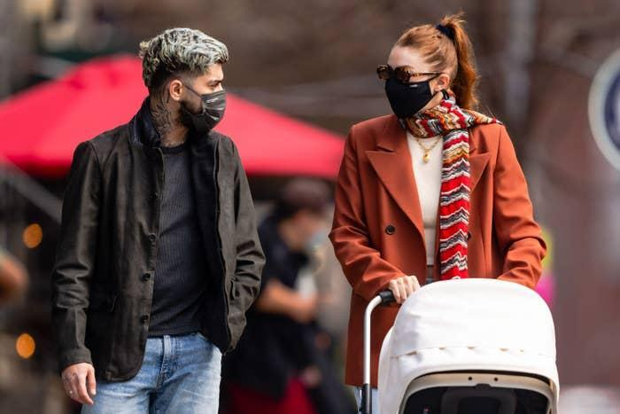 Zayn Malik and Gigi Hadid are pictured pushing a stroller in New York City