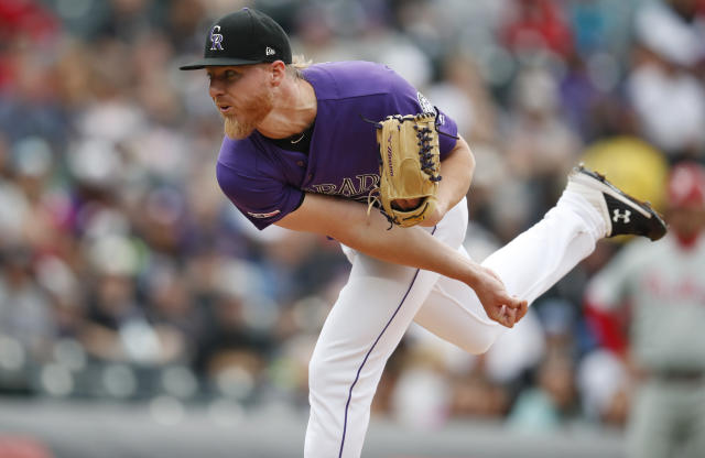 Colorado Rockies starting pitcher Jon Gray works against the Philadelphia Phillies in the first inning of a baseball game Sunday, April 21, 2019, in Denver. (AP Photo/David Zalubowski)