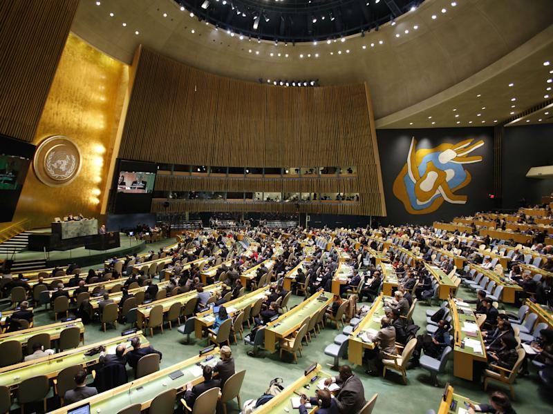 People gather at the United Nations General Assembly prior to the vote: AP