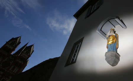 FILE PHOTO - Statue of Virgin Mary adorns the facade of the bishop's residence next to Limburg Cathedral