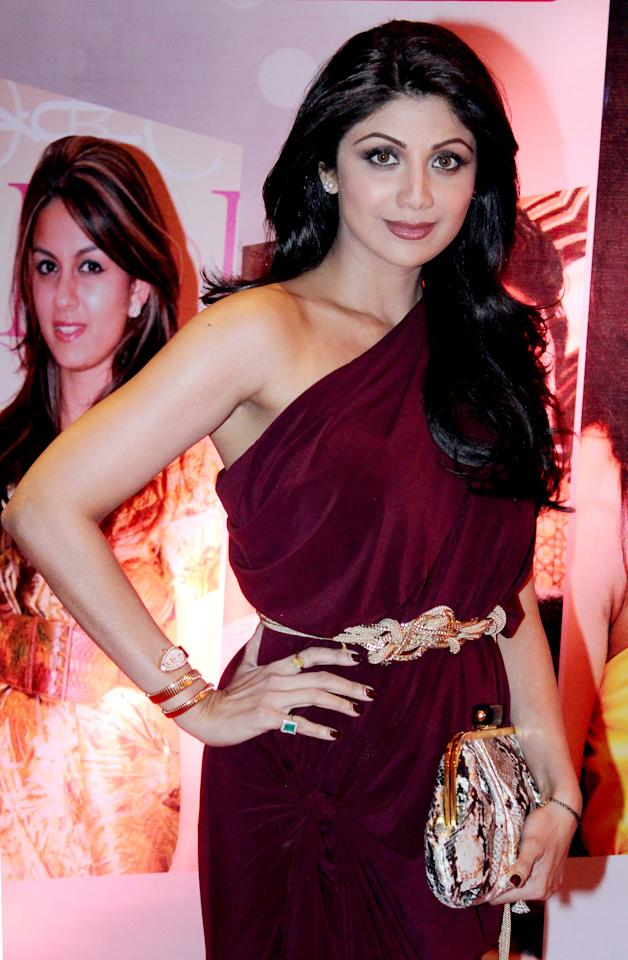 Yummy mummy Shilpa Shetty shows off her slimmer frame in this rich oxblood outfit.