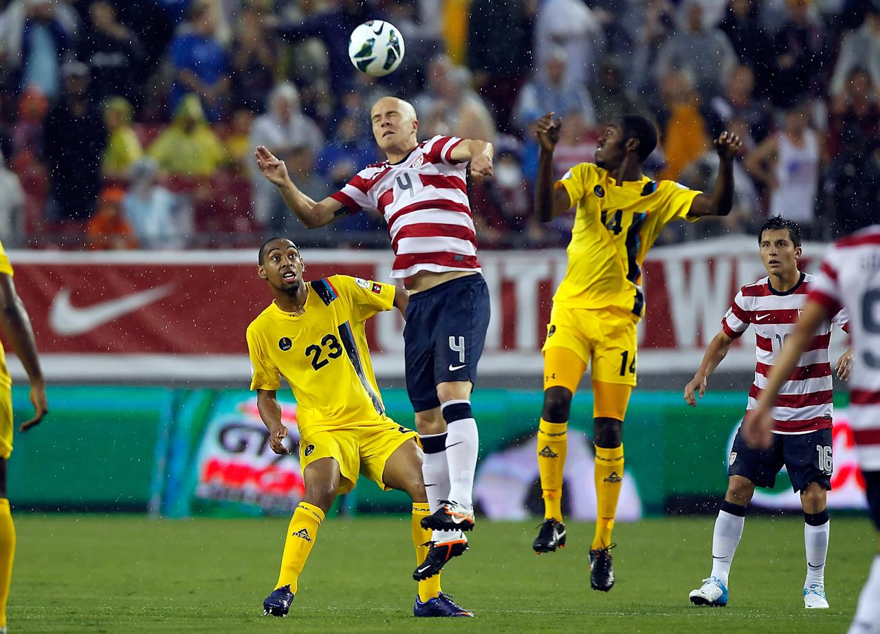 TAMPA, FL - JUNE 08:  Midfielder Michael Bradley #4 of Team USA heads the ball against Team Antigua and Barbuda during the FIFA World Cup Qualifier Match at Raymond James Stadium on June 8, 2012 in Tampa, Florida.  (Photo by J. Meric/Getty Images)