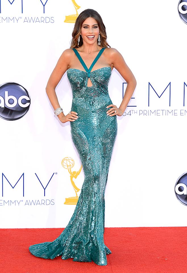 "Sofia Vergara Grade: A Va-va-voom! Sofia Vergara shimmered in a hand-beaded teal Zuhair Murad gown that made her look a little like mermaid. The ""Modern Family"" siren accessorized with over 175 carats of Neil Lane Diamond Hollywood Jewels."