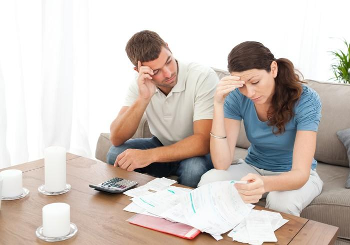 Couple working on finances and debt repayment together