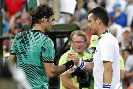 Mar 28, 2017; Miami, FL, USA; Roger Federer of Switzerland (R) shakes hands with Roberto Bautista Agut of Spain (R) after their match on day eight of the 2017 Miami Open at Crandon Park Tennis Center. Mandatory Credit: Geoff Burke-USA TODAY Sports