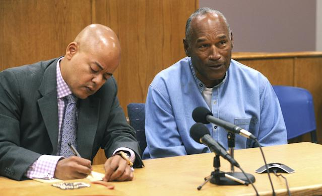 <p>Former NFL football star O.J. Simpson, right, reacts after learning he was granted parole at Lovelock Correctional Center in Lovelock, Nev., on Thursday, July 20, 2017. Simpson was convicted in 2008 of enlisting some men he barely knew, including two who had guns, to retrieve from two sports collectibles sellers some items that Simpson said were stolen from him a decade earlier. (Jason Bean/The Reno Gazette-Journal via AP, Pool) </p>